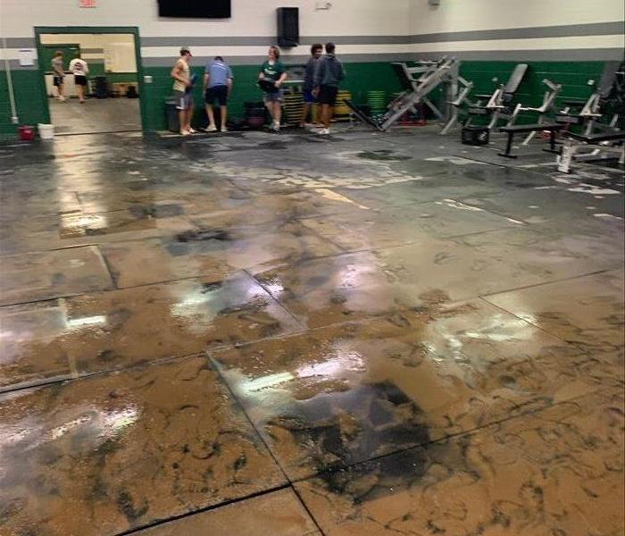 Mud and water cover the field house floor