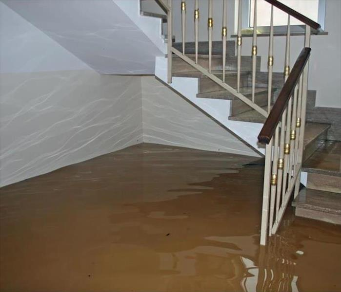 flooded room with staircase