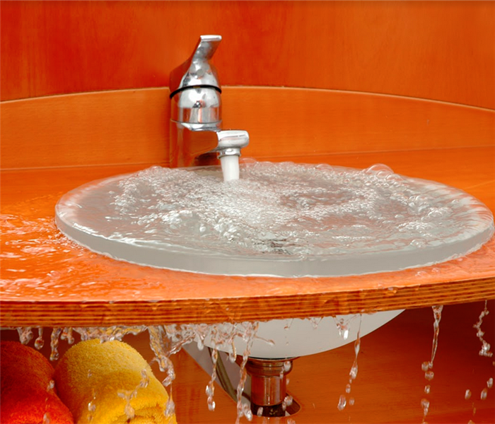 water overflowing from an orange sink