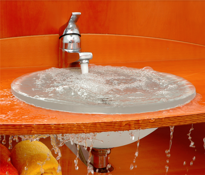 overflowing sink with orange counter