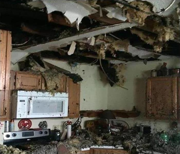 A kitchen covered in debris after a fire